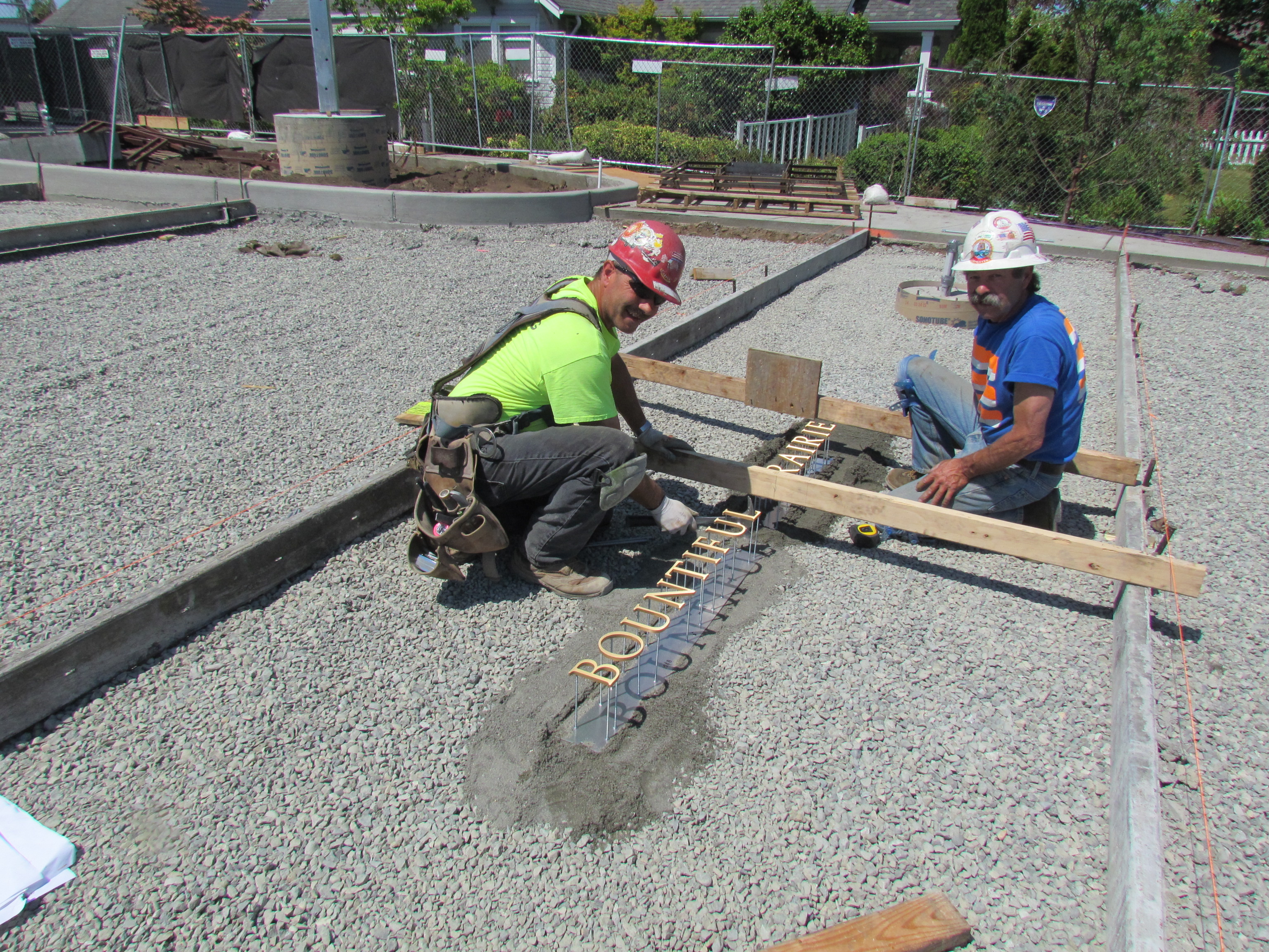 Men Working on Plaza Letters