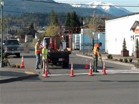 City crew laying down crosswalks
