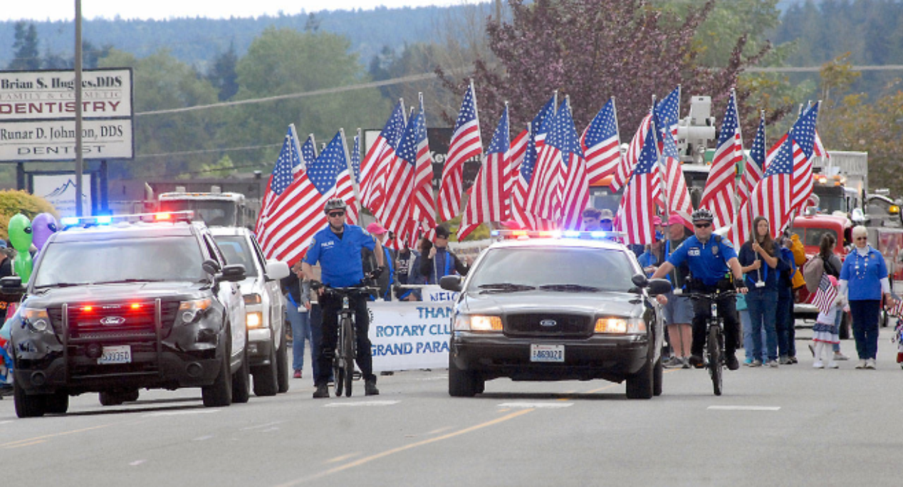 Sequim Police Officers leading the annual Sequim Irrigation Parade