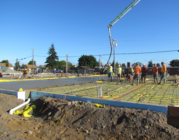 concrete pour on east side of bldg